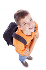 Above view of a smiling school boy with backpack, isolated on wh
