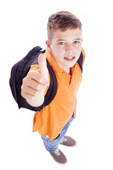Smiling school boy with backpack thumbs up, isolated on white ba