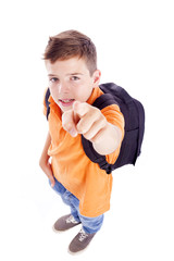 Smiling school boy with backpack pointing at you, isolated on wh