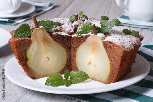Chocolate cake with whole pears and mint closeup horizontal - 68809756