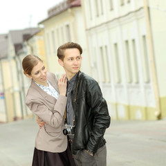Young fashion couple outdoor vintage portrait.