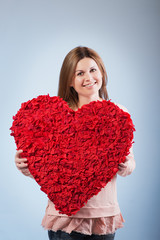 beautiful happy woman hold Valentine day symbol