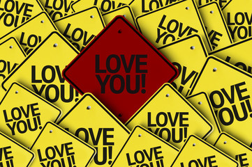 Love You written on multiple road sign