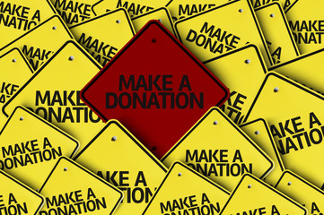 Make a Donation written on multiple road sign