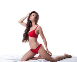 Attractive slim brunette posing in red lingerie