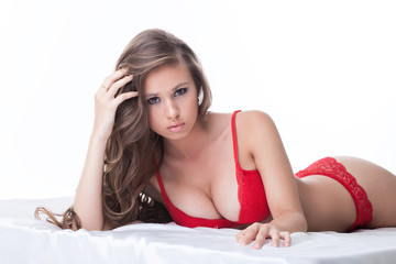 Portrait of busty model posing in red lingerie
