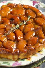 Tarte Tatin with peaches and thyme.