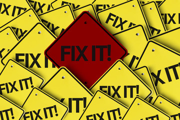 Fix It! written on multiple road sign