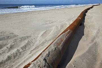 rusty pipes along the sea beach