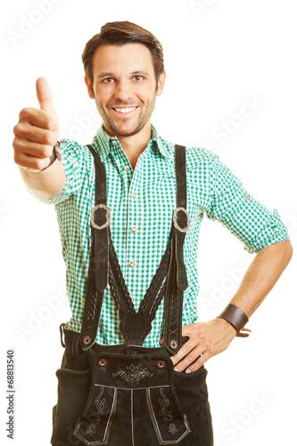 canvas print picture Mann in Lederhose hält Daumen hoch
