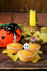 traditional halloween treats cupcakes with funny candles