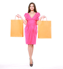 Fashion shopping girl. Beauty woman with shopping bags on a whit