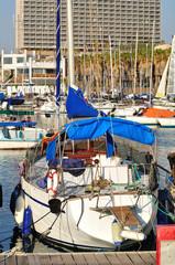 Small yacht at the marina of Tel Aviv seashore.