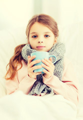 ill girl child with cup of hot tea