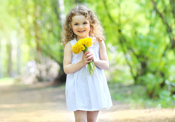 Sunny spring portrait of adorable smiling cute little girl with
