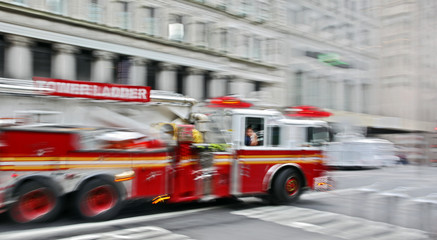 fire trucks and firefighters brigade in the city