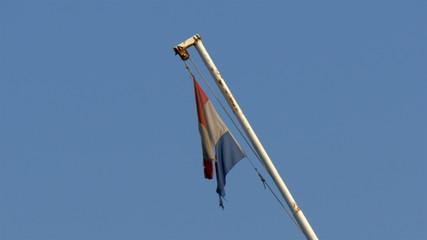 An old wreckage flag on the pole. GH4 4K UHD