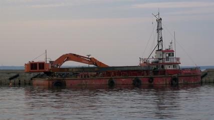 An old excavator on dock on the sea of Estonia GH4 4K UHD