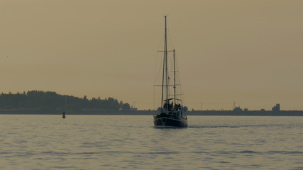 A small yacht on sail on the ocean water GH4 4K UHD
