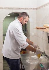 chef makes pizza