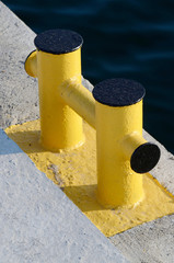 Yellow bollard pier - device for yacht mooring