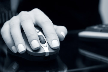 Female hand using computer mouse
