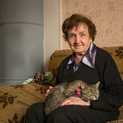 Elderly woman with her cat.