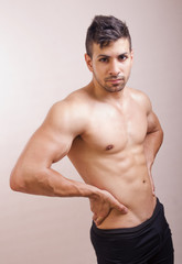Shirtless guy posing in studio shot