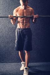 Shirtless fitness man lifting weights