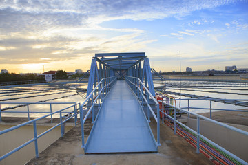 perspective of metal bridge for working in big tank of water sup