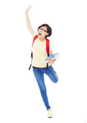 happy young student girl running and raising a hand