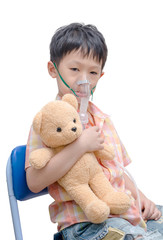 Little Asian boy using oxygen mask on white background
