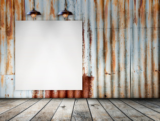 Blank frame on Rusted galvanized iron plate with wood floor
