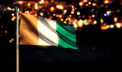 Cote D'Ivoire National Flag City Light Night Bokeh Background 3D