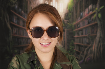 Portrait of young girl wearing military jacket and sunglasses