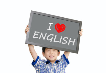 """Little Asian boy holding chalkboard with message """"I love English"""