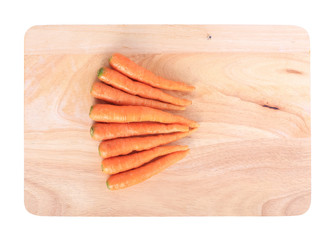 carrot on wooden chopping board