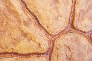 rough brown stone tile floor