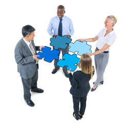 Business People Connecting Jigsaw Puzzles