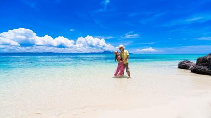 man and woman  at the sea