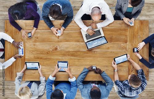 Leinwanddruck Bild Group of Business People Using Digital Devices