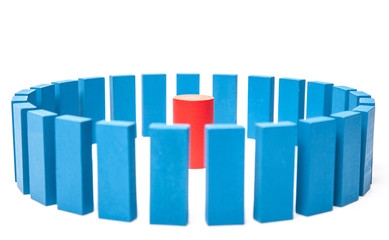 Circle of blue building blocks surround single red one