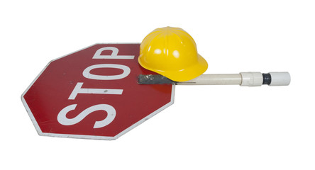 Stop Sign on a Short Pole with a Construction Hat
