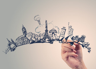 hand drawn traveling around the world on wooden background as co