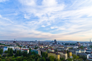 Vienna cityscape at sunset, different ages, styles and colors