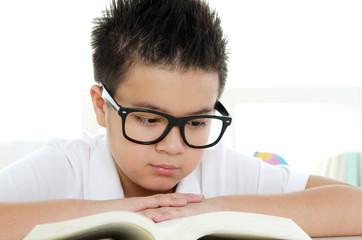 Asian boy reading a book