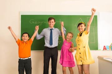 Happy teacher and his pupils