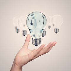 hand showing 3d light bulb as vintage concept