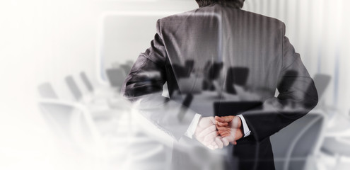 Double exposure of businessman success with his board room backg