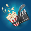 pop corn with film strip and movie clapper